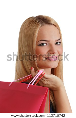 Beautiful young blonde woman with a shopping bags over her shoulder.