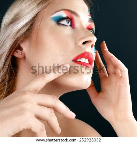 Beautiful young blonde woman with italian flag creative make-up studio shot - stock photo