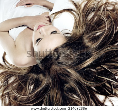 beautiful young blonde woman with wonderful hair  - stock photo
