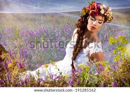 beautiful young bride in a wreath - stock photo