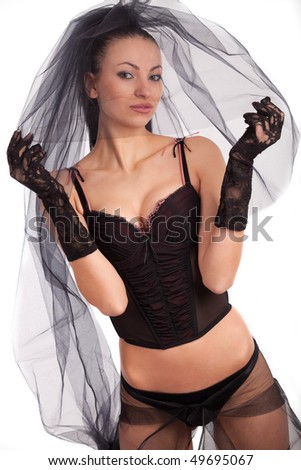 Beautiful young bride in black studio portrait - stock photo