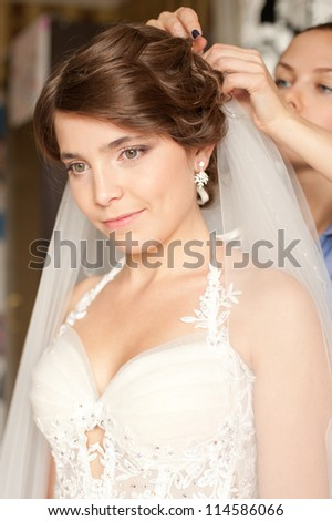 Beautiful young bride is preparing for her wedding day