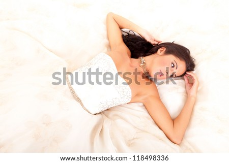 Beautiful young bride, posing over white background