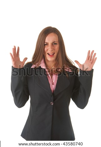 Beautiful young brunette businesswoman in business suit screaming of frustration on white background. Not isolated