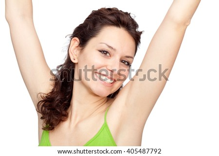 beautiful young brunette girl with arm up isolated on white