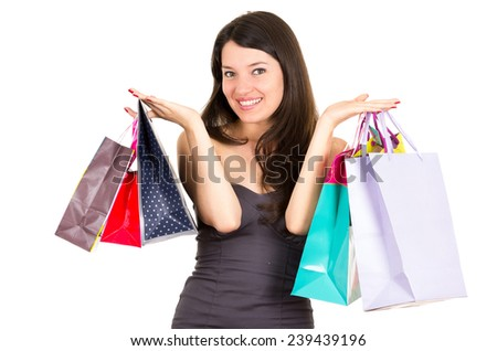 beautiful young brunette happy woman holding bags shopping isolated on white