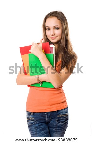 Beautiful young brunette student girl showing thumbs up. - stock photo