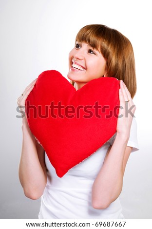beautiful young brunette with red heart isolated on white background - stock photo