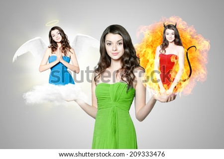 Beautiful young brunette woman choosing between angel and devil - stock photo