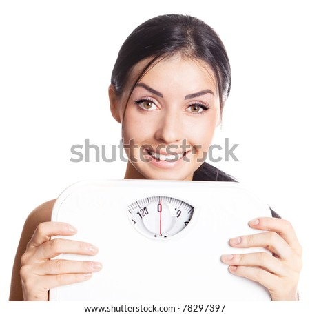 beautiful young brunette woman  holding scales - stock photo