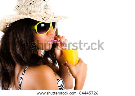 Beautiful young brunette woman in cowboy hat and sunglasses enjoying a cocktail with puckered lips - isolated on white - stock photo