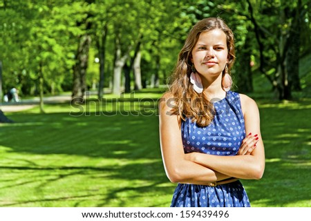 beautiful young brunette woman outdoor on the meadow on a summer day - stock photo