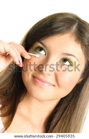 beautiful young brunette woman removing makeup with a wadded stick - stock photo