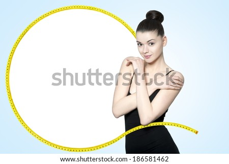 Beautiful young brunette woman - slim body care concept - stock photo