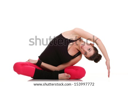 beautiful young brunette woman stretching the muscles of her arms and back, isolated against white background - stock photo