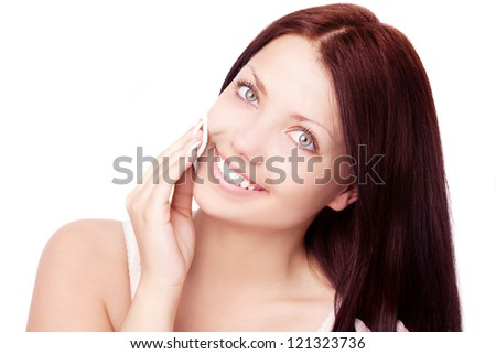 beautiful young brunette woman using cotton pads, isolated against white background - stock photo