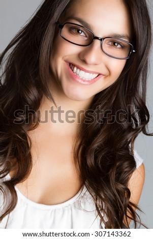 Beautiful young brunette woman wearing glasses - stock photo