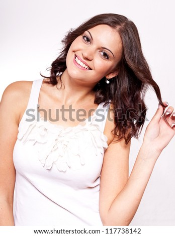 beautiful young brunette woman with big smile on white - stock photo