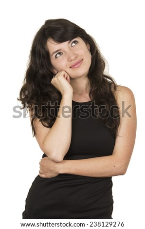 beautiful young brunette woman with black top posing with hand on chin daydreaming isolated on white - stock photo