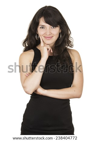 beautiful young brunette woman with black top posing with hand on chin isolated on white - stock photo