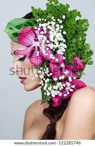 Beautiful young brunette woman with orchid . Wedding Hairstyle.