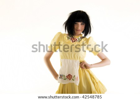 Beautiful young brunette woman with tousled hair wriggling on camera - stock photo