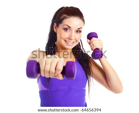 beautiful young brunette woman working out with two dumbbells
