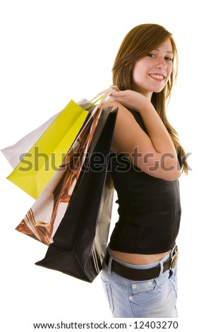 Beautiful young business lady walking with shopping bags, isolated on white. - stock photo
