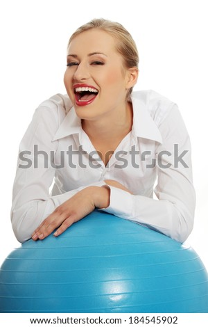 Beautiful young business with exercise ball. Isolated on white. - stock photo