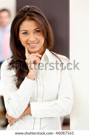 Beautiful young business woman at the office - stock photo