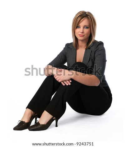 Beautiful young business woman sitting