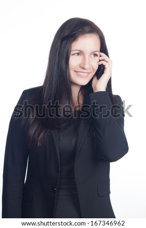 Beautiful young business woman talking on the mobile phone