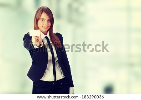 Beautiful young business woman with blank business card - stock photo