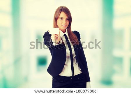 Beautiful young business woman with blank business card isolated on white background  - stock photo