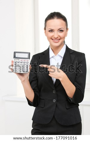 beautiful young business woman with calculator. isolated on white background smiling girl - stock photo