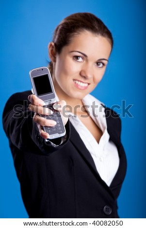 Beautiful young businesswoman calling by cellular phone.