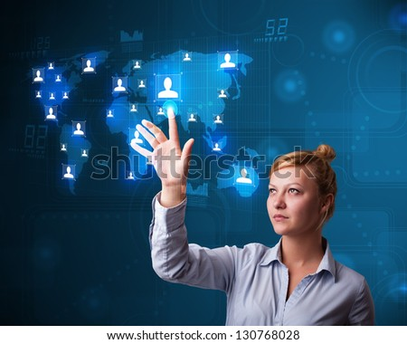 Beautiful young businesswoman choosing from social network map