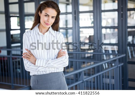 Beautiful young businesswoman in office - stock photo