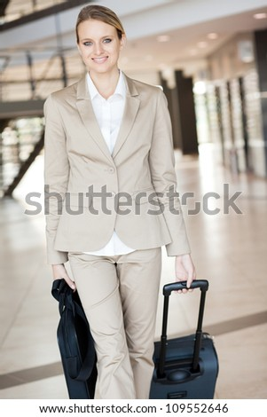 beautiful young businesswoman walking at airport - stock photo