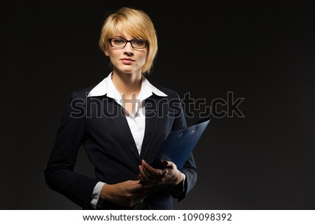 Beautiful young businesswoman with document case - stock photo