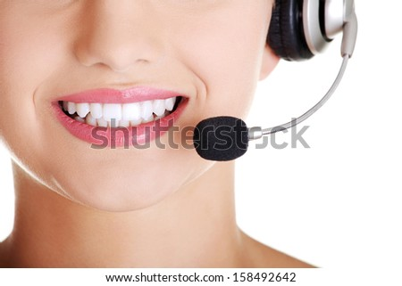 Beautiful young call-center assistant smiling , isolated  - stock photo
