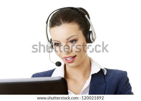 Beautiful young call-center assistant smiling , isolated on white - stock photo
