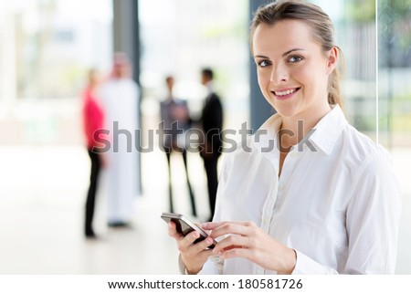 beautiful young career woman using cell phone - stock photo