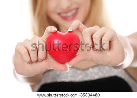 Beautiful young casual woman holding red heart, isolated on white - stock photo