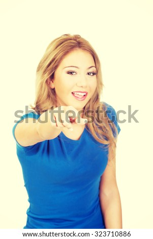Beautiful young casual woman pointing on you. - stock photo