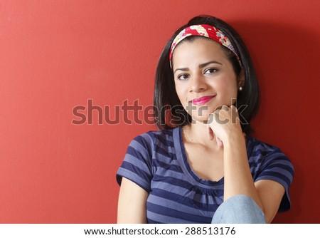 Beautiful young casual woman smiling - stock photo