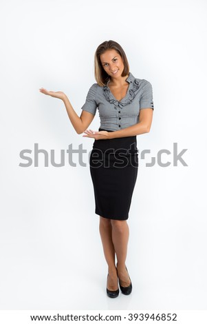 Beautiful young caucasian business woman smiling in full length, pointing upwards, with hand held in a holding position, showing copy space. Isolated on a white background - stock photo