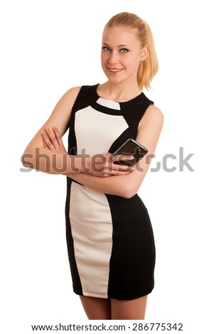 Beautiful young caucasian business woman with smartphone communicating - stock photo
