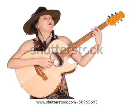 Beautiful young caucasian girl in a cowboy hat with a guitar over white background