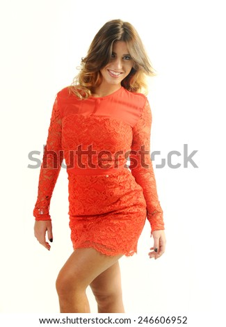 Beautiful Young caucasian girl wearing bright orange lace dress dancing isolated on White background - stock photo